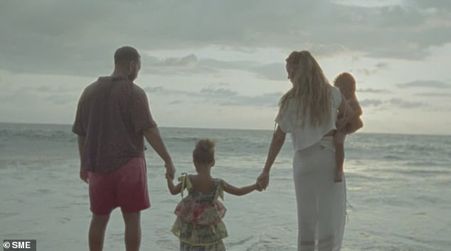 Family fun: The couple take in the views with their children
