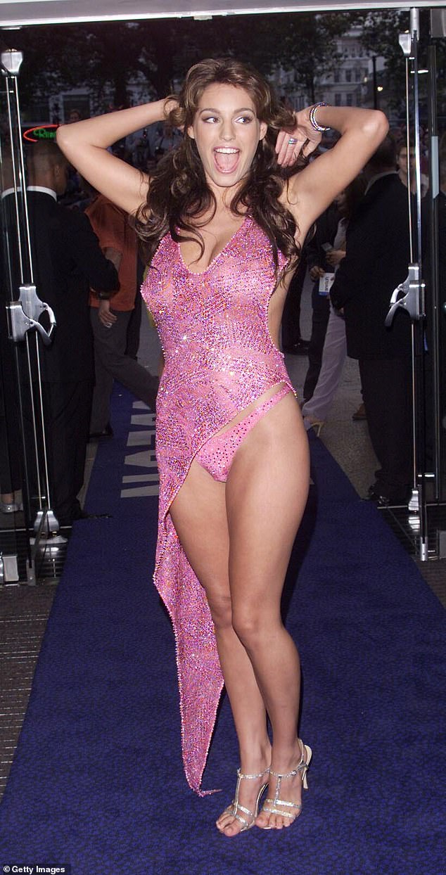 Iconic: Kelly made headlines everywhere when she wore this daring pinkJulien Macdonald dress to the premiere ofSnatch in 2000
