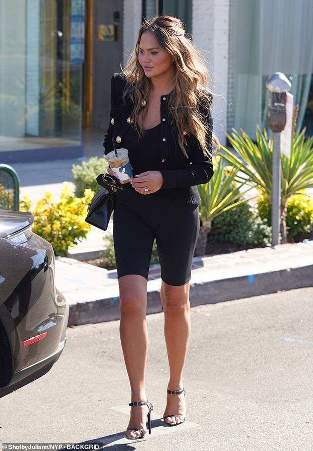 Leggy look: The model added to her height with black strappy stilettos