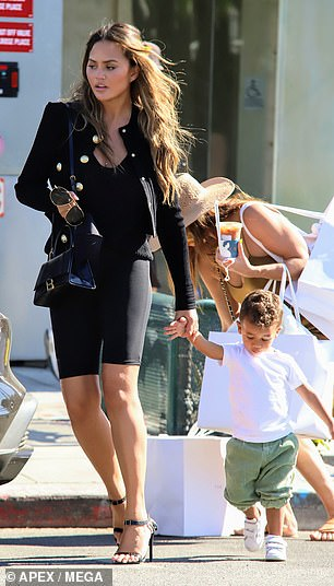 Chrissy was a hands-on mom on the outing
