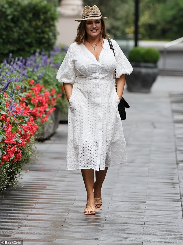 Kelly Brook is stylish in white dress and fedora… after revealing trolls have branded her 'unsexy'