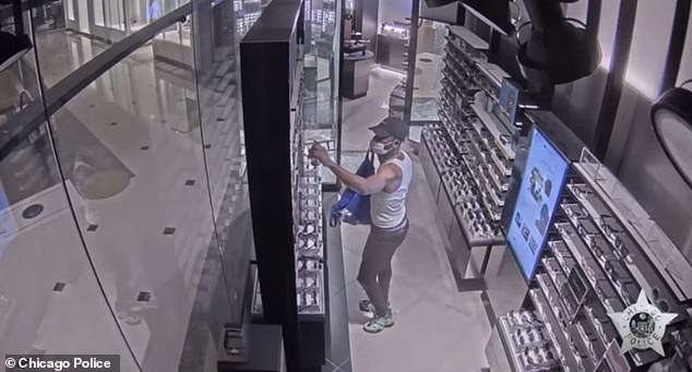 CCTV footage captured two looters break into a Sunglass Hut in Chicago on Monday night