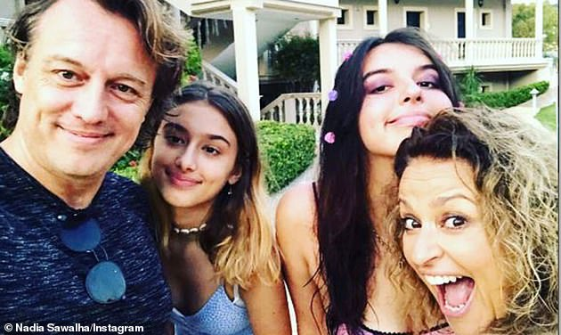 Candid:On making her return to the show, Nadia appeared to allude to the row as she revealed that being on her period made her family 'suffer' while being around her (pictured with husband Mark and their daughters Maddie, 17, and Kiki, 12)