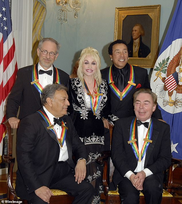 Parton (center) was awarded a Kennedy Center Honors award back in 2006, which she received at the US State Department