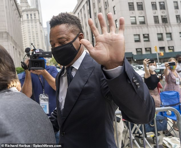 Hiya: Gooding Jr. waved at photographers who had gathered at the court before his arrival
