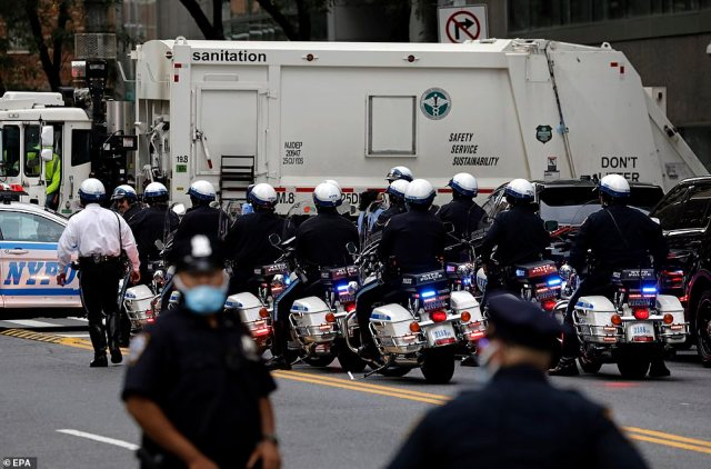 Trump's New York motorcycle escort waits outside at New York Presbyterian Hospital in New York