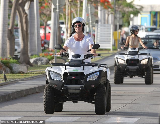 Disappointment: But now Simon's girlfriend, 43, is believed to be shutting down her thrill-seeking means amid reports that she has banned him from all high-octane activity (pictured previously on a quad in the Caribbean)