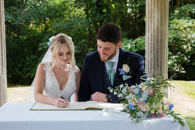 Man and wife: Lissie and Andrew sign the wedding register following their marriage in July last year