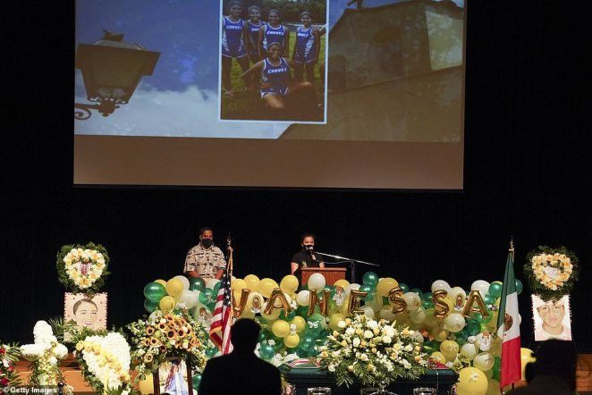 Lupe Guillen, Guillen's sister, stands at the podium and speaks during her memorial service at Cesar Chavez High Schoo