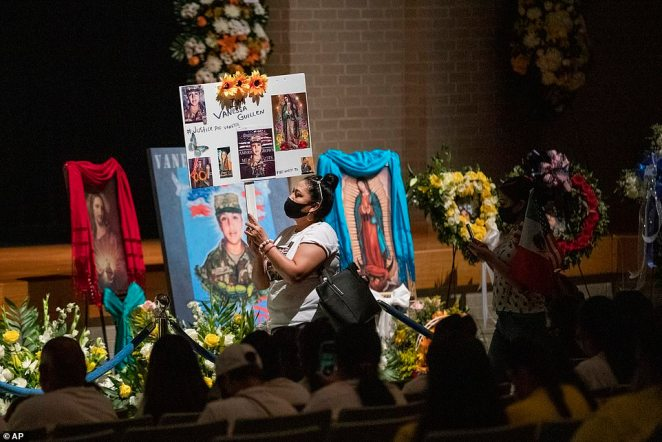 Rosa Samaniego holds a sign demanding justice for Guillen while attending her memorial service at the high school