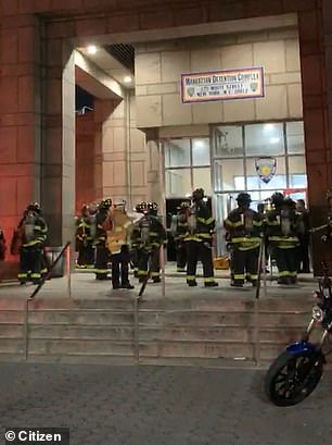 Firefighters are seen outside the jail's entrance