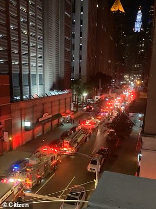 Fire trucks are seen on the street near the jail while the FDNY responded to the fire, which started at about 8.30pm Friday night