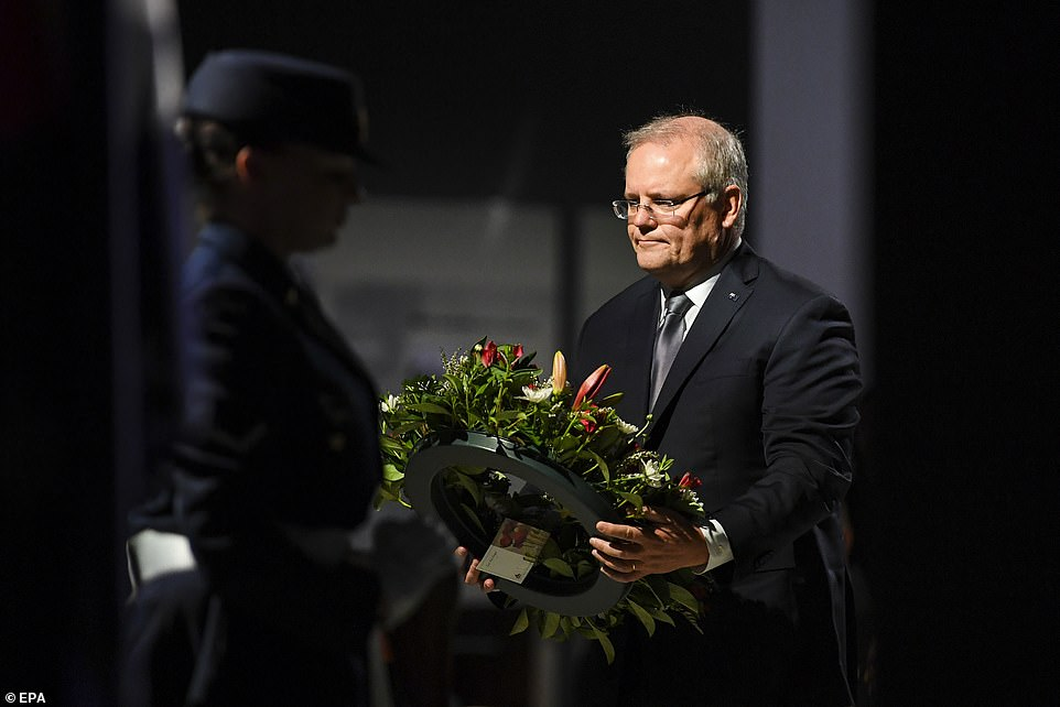 Australian Prime Minister Scott Morrison lays a wreath during a service to commemorate the 75th anniversary of the Victory in the Pacific Day at the Australian War Memorial in Canberra, Australia, 15 August 2020