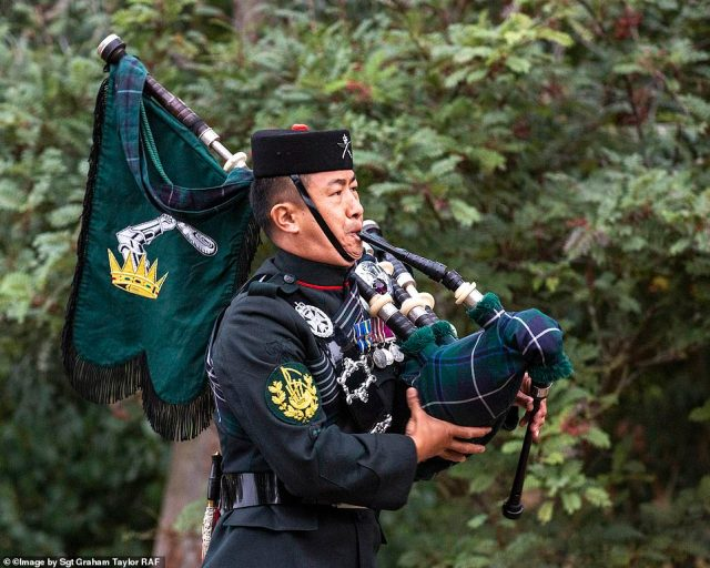 Image shows Colour Sergeant Lil Bahadur Gurung playing the pipes. C Sgt Gurung is a Pipe Major in the uniform of 1 Royal Gurkha Rifles and is the lone piper at the VJ Day 75 Commemorations held at the National Memorial Arboretum, Alrewas, Staffordshire on 15 August 2020