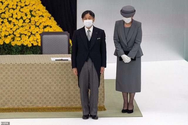 Japan's Emperor Naruhito (left) and Empress Masako (right) wearing face masks, attend a memorial service marking the 75th anniversary of Japan's surrender in World War II at the Nippon Budokan hall in Tokyo, Japan, 15 August 2020. On 15 August 1945, following the atomic bomb attacks on Hiroshima and Nagasaki, former emperor Hirohito formally announced Japan's surrender to allied forces, bringing the hostilities of World War II to an end