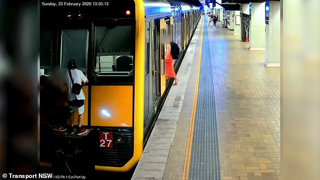 Footage shows two teens run out of the train and jump onto the back of the carriage