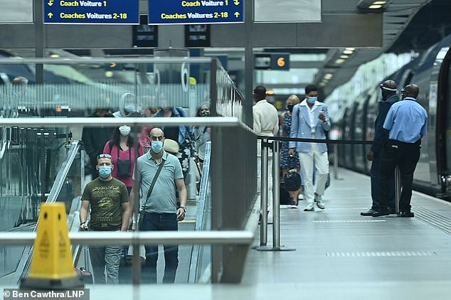 Travellers from France arrive at the Eurostar terminal at St Pancras International after France was removed from the list of safe countries people can travel to without going into quarantine