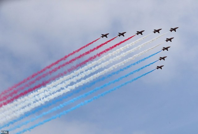 The Red Arrows fly over the Titanic slipway, the Titanic Museum and the Samson and Goliath cranes in Belfast as part of their UK-wide flypast to mark VJ Day