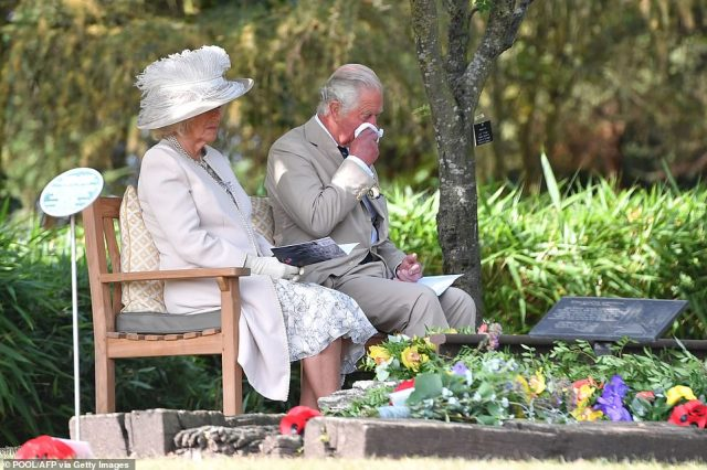 Britain's Camilla, Duchess of Cornwall and Britain's Prince Charles, Prince of Wales attend a national service of remembrance at the National Memorial Arboretum in Alrewas, central England today, to mark the 75th anniversary of VJ (Victory over Japan) Day