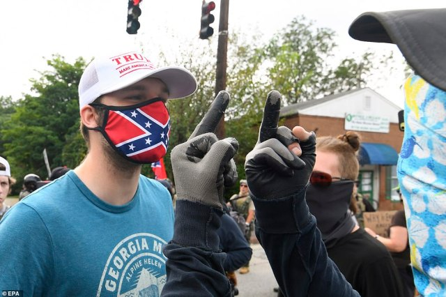 Members of right-wing groups clashed with counter-protesters (pictured) after members of the Black Lives Matter movement and Antifa groups descended on the event