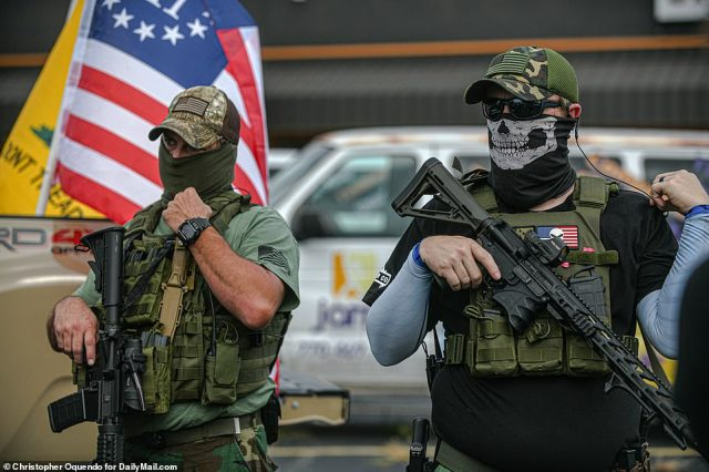 Heavily armed militia marched in downtown Stone Mountain as part of a rally 'to defend and protect our history and second Amendment rights'