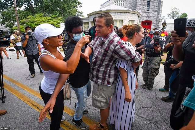 Demonstrators and counter-demonstrators are held back from each other as tensions flared between the two