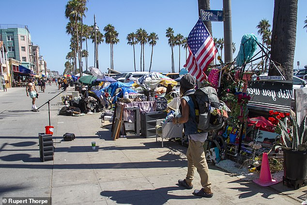 Makeshift tents line the popular tourist destination of Venice Beach.'For Sale' signs are seemingly dotted on every suburban street as the middle classes, particularly those with families, flee for the safer suburbs, with many choosing to leave LA altogether