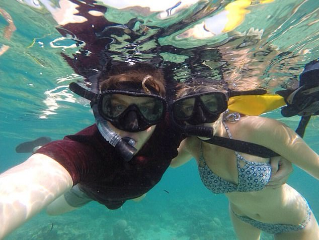 Truly, madly, deeply in love: Ever adventurous, snorkelling on their seven-month trip around the world in their early 20s
