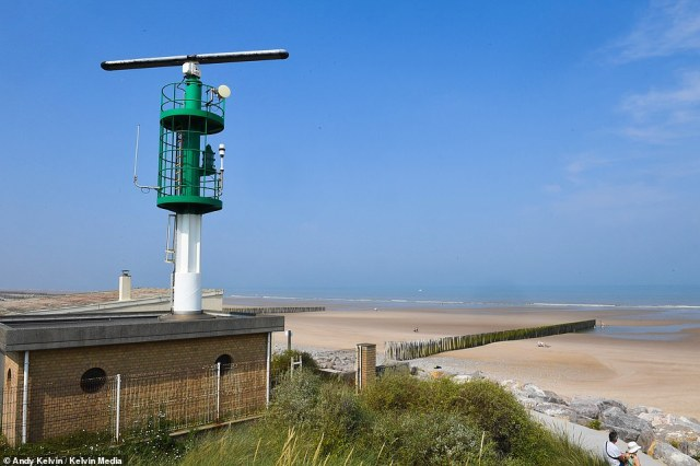 A French radar station is pictured aboveon Sangatte beach, monitoring the Channel traffic.Macron's stance coincided with a push in Calais to restore the city's image as an attractive tourist destination, rather than a hub for migrants smuggling themselves to the UK in lorries or boats