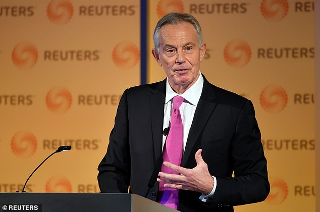 Tony Blair, pictured at an event in London in November 2019, said another national lockdown was 'not possible' because of the economic damage it would cause