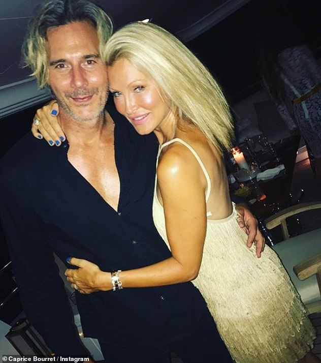'It was a stressful start to her holiday': The blonde has been moving on from a 'terrifying' raid which took place at her holiday house in Ibiza last month (pictured with husband Ty Comfort)