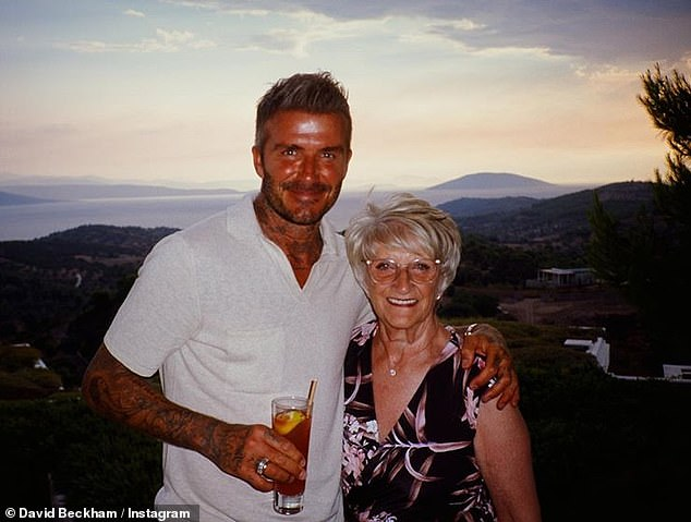 David posed with his mum, Sandra Beckham, in another snap, captioning it: 'Last time I was on a long holiday with mum it was Butlins ♥️'