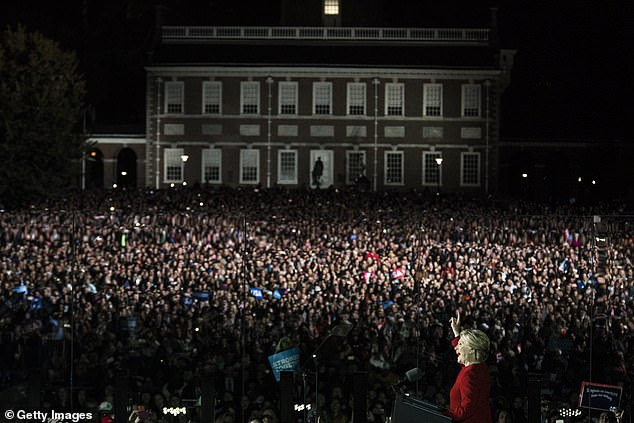 Hillary Clinton is seen saluting her supporters on the final night of her 2016 campaign outside Independence Hall in Philadelphia, Pennsylvania