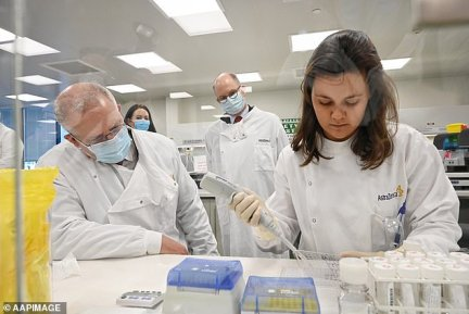 Prime Minister Scott Morrison watches scientists in the Astra Zeneca laboratory in Macquarie Park in Sydney on Wednesday