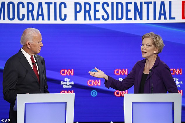 Former rivals: Elizabeth Warren and Joe Biden sparred in Democratic primary debates (seen here on stage in Ohio in October 2019) before Warren eventually dropped out