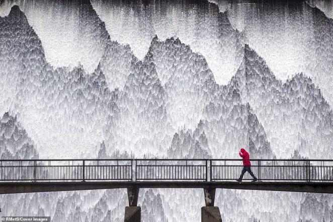 Wet Sleddale Dam, in Shap, Cumbria, was pictured by Andrew McCaren. A visitor in a bright red coat contrasts dramatically with the sheets of water cascading down the dam wall. The artificial reservoir is set amongst the Shap Fells and lies just within the boundary of the Lake District National Park in the UK