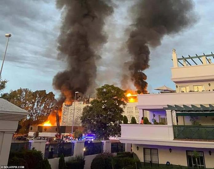 Witnesses reported hearing a loud explosion before flames ripped through the hotel which had to be evacuated, as well as a neighboring building.