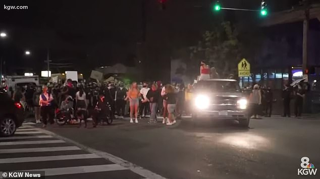 In addition to the ICE protest, around 100 people marched to the offices of Portland's police union on Thursday night