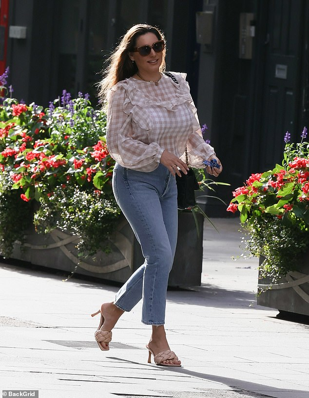 Looking lovely: The model put on a stylish display in her chic look as she exited Global Studios after hosting her radio show