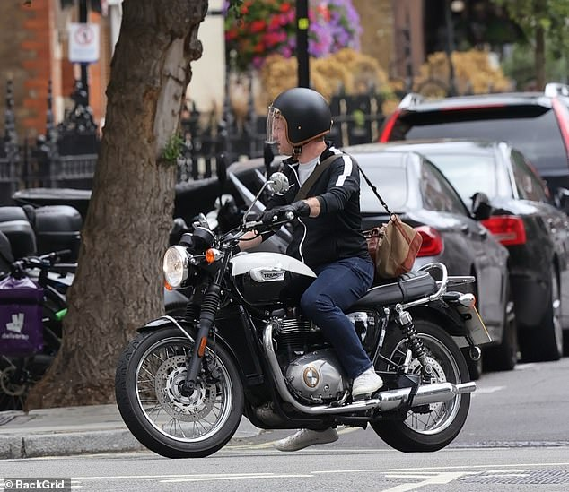 Ride: Wearing a black Nike top with indigo jeans, the broadcaster jumped on his motorcycle