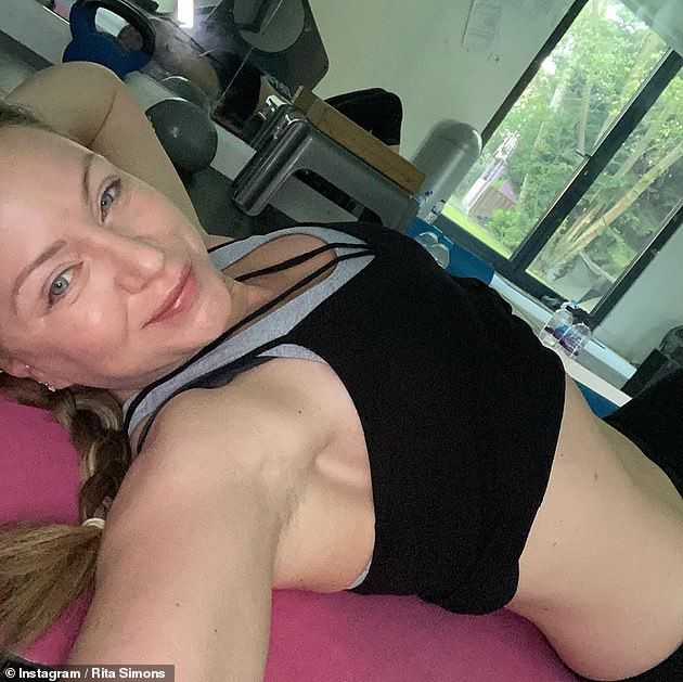 Sensational: Rita displayed her washboard abs in a vest top and leggings as she hailed the benefits of exercise for lifting her out of a 'dark' mental space