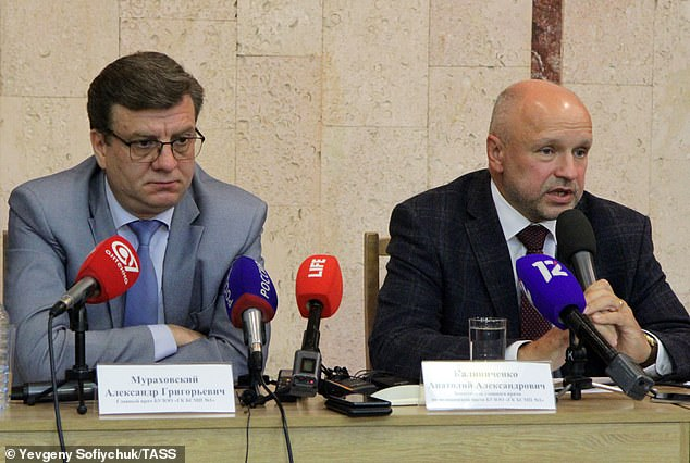 Chief doctor of the Omsk hospital that treated Navalny Alexander Murakhovsky, left, and head physician and deputy Anatoly Kalinichenko. They denied claims they were pressurised by the Kremlin into saying that they had detected no traces of poison in his blood