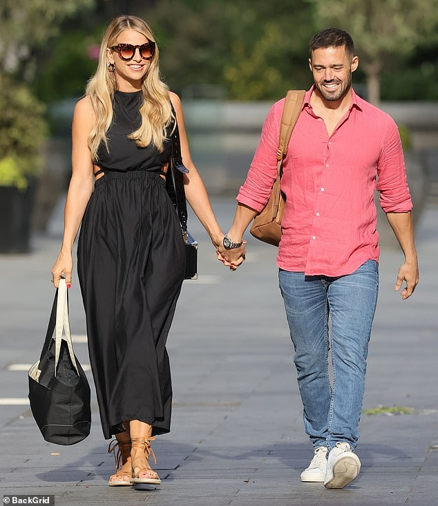 Loved-up: New mum Vogue Williams had a spring in her step as she stepped out with husband Spencer Matthews hand-in-hand in London on Sunday