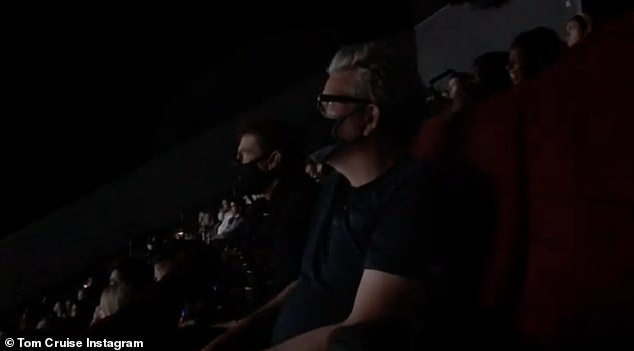 Exciting: The video then sees the Hollywood star sitting in the cinema while wearing her mask surrounded by other moviegoers