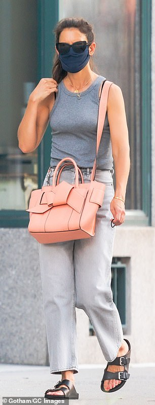 She changed her mind: Holmes swapped her old-fashioned black bag for a larger pink purse in the Tribeca neighborhood