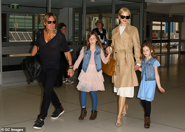 Second chance:Following her divorce from Tom, Nicole married country singer Keith Urban (left) in 2006. They went on to welcome two daughters, Sunday, 12, and Faith, nine. They are pictured in Sydney in March 2017