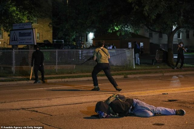 The armed man got back to his feet while the injured man lay on the ground and bystanders screamed and ran in terror