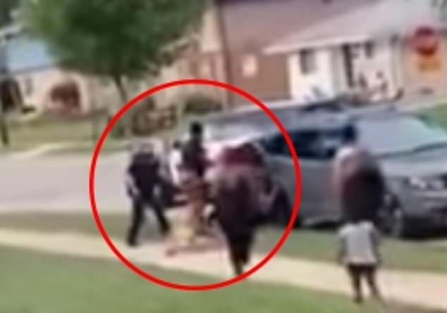 Newly revealed Amateur cell phone video shot from a different angle on Sunday shows Blake entangled in a physical altercation with at least two police officers in Kenosha, Wisconsin