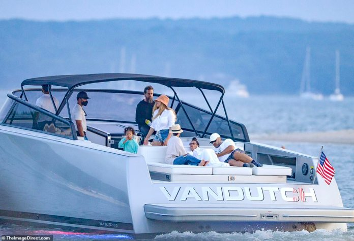Splashing about: The couple opted for a small yacht for their excursion to the Hamptons