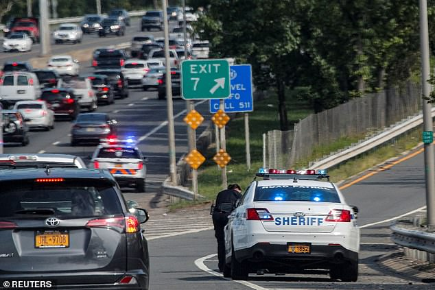 New York City Sheriff stops an out of state car at a COVID-19 checkpoint in Staten Island
